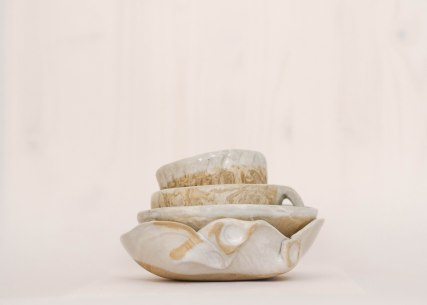 hand-built, marbled clay vessels